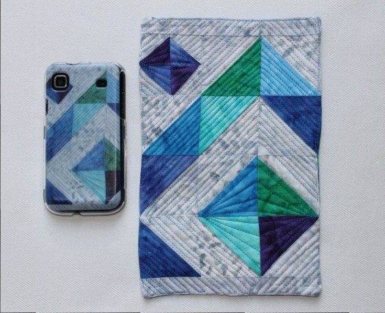 My one-of-a-kind phone case (left) and the original mug rug (right)