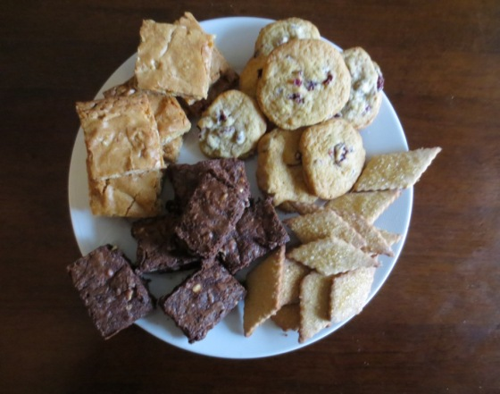 Clockwise from upper left: butterscotch bards, cranberry chocolate chip cookies, honey spice cookies, reverse chocolate chip cookies